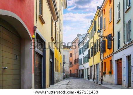 Many colorful old houses on the street in Parma, Emilia Romagna province, Italy. - stock photo