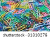 many colorful paper clips background - stock photo
