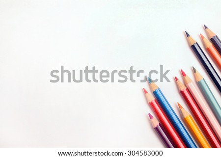 Many colorful pencil with white paper - stock photo