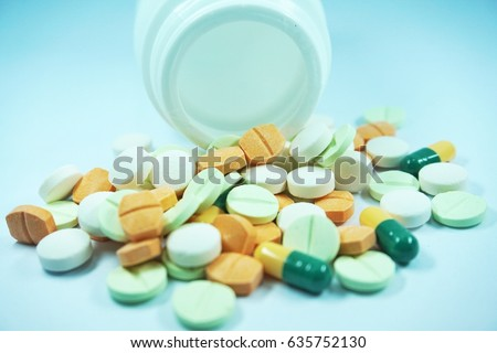 many colorful pill on white background.