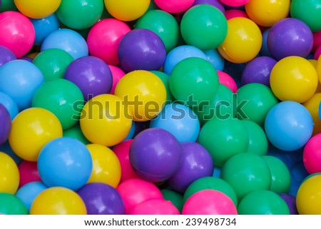 Many colorful plastic balls on children's playground - stock photo
