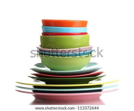Many colorful plates isolated on white - stock photo