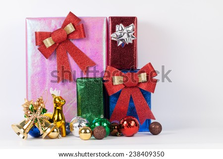 Many colorful presents with luxury ribbons on white background