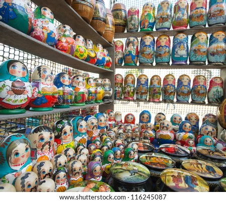 Many colorful russian dolls in a rows