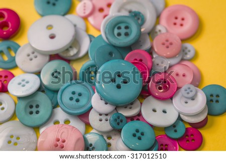 Many colorful sewing buttons texture background - stock photo