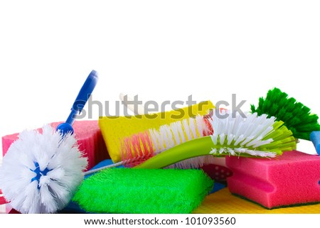 Many colorful sponges and brushes for housework isolated on white