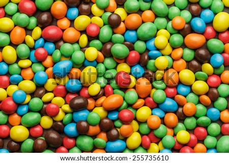 many colorful sweets on the table background - stock photo
