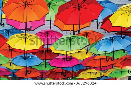 many colorful umbrellas - stock photo