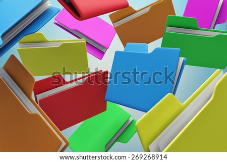 Many colour folders chaotically flying in air - stock photo