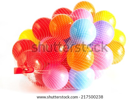 Many colour plastic balls on white background - stock photo