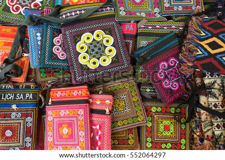 many colourful embroidered purses and wallets for sale, northern Vietnam
