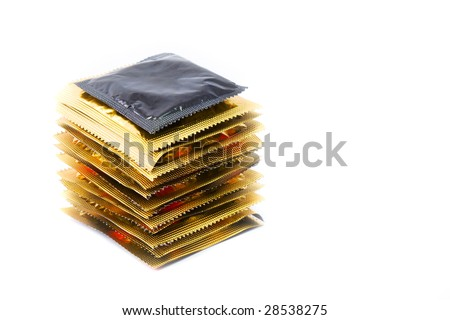 Many condoms in isolated on white stack - stock photo