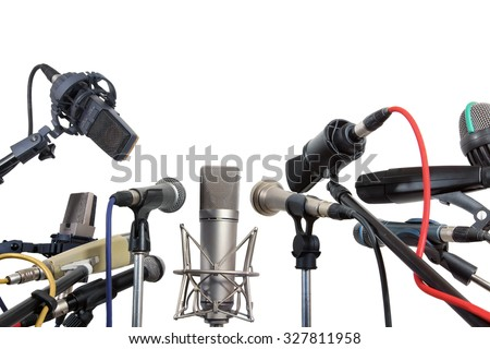 Many conference meeting microphones prepared for talker - isolated on white background  - stock photo