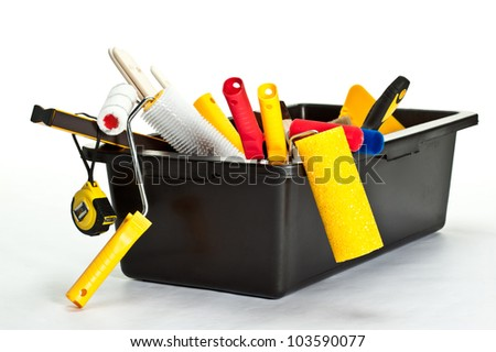 Many construction tools inside a container on white background