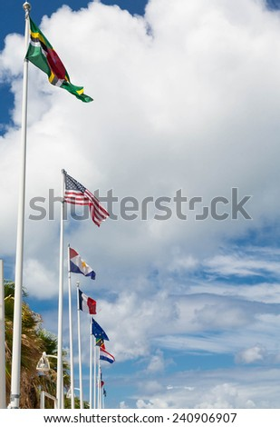 Many country's flags flying over the port in Marigot, St Martin
