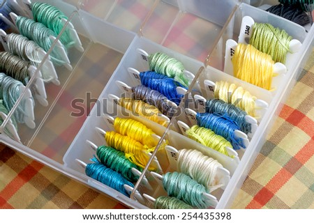 Many Cross-stitch lines neatly placed in the box - stock photo
