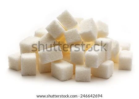 Many cubes of sugar on the white background - stock photo