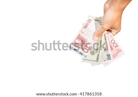 Many currency banknotes on hand - stock photo