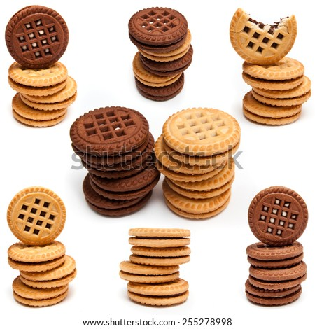 many delicious biscuits with cream isolated on white background - stock photo