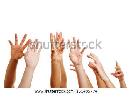 Many desperate hands reaching up into the air - stock photo