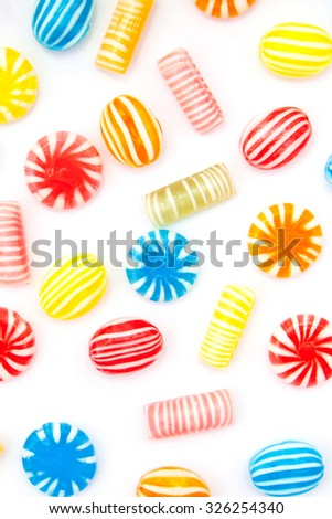 many different color candies on white - stock photo