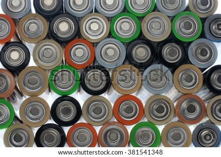 many different colorful batteries isolated on white background