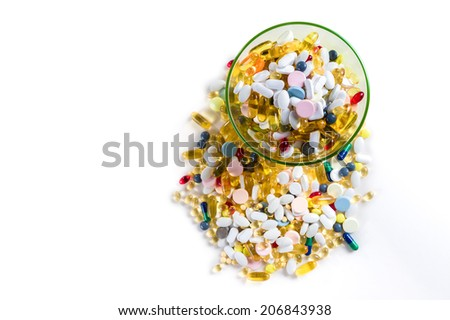 Many different colorful medication and pills from above on white background with copy space
