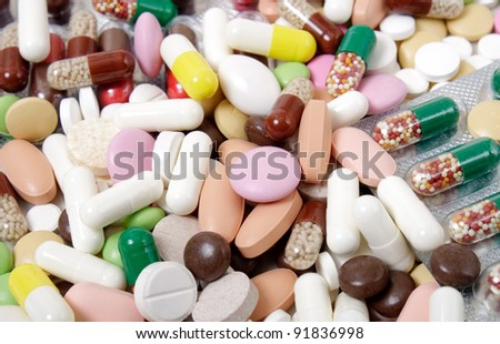 many different colorful pills. background - stock photo