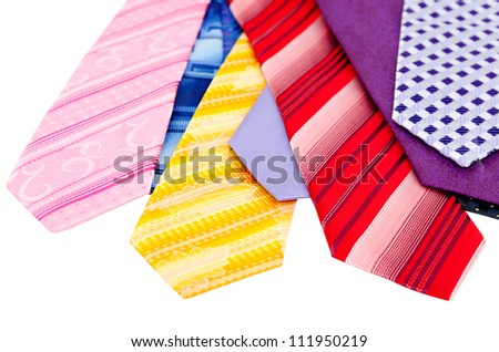 many different colurful ties, isolated over white