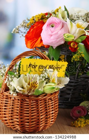 Many different flowers in baskets on room background