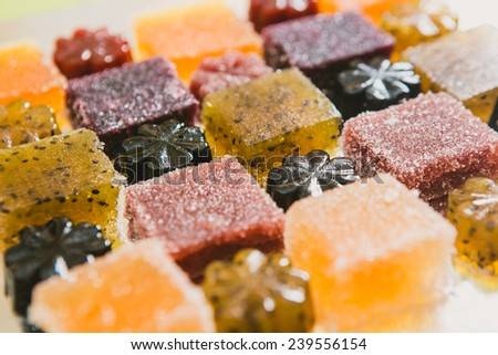 Many different fruit paste candies. Whole background. Selective focus. warm colors - stock photo