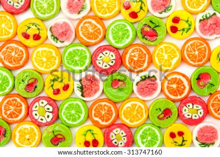 many different tasty candies, background - stock photo
