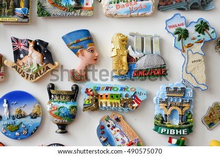 many different travel magnet souvenir on the white fridge