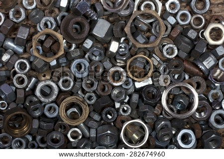 many different washers and nuts as background