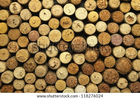 many different wine corks in the background - stock photo