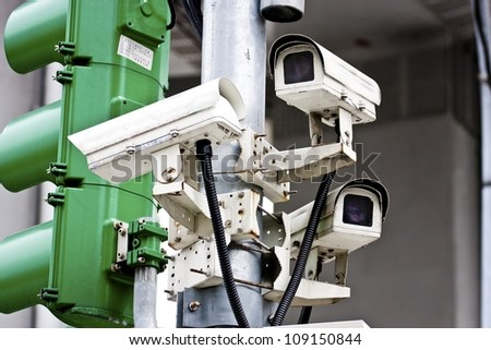 many direction security camera set together in the corner of street - stock photo