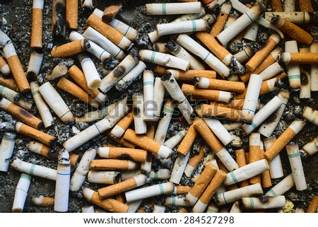 Many dirty cigarettes butts background - stock photo