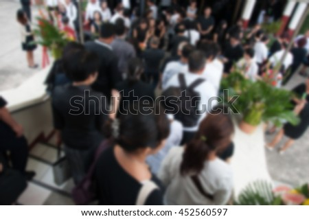 Many distinguished guests to the funeral wearing black to mourn. Blur abstract.