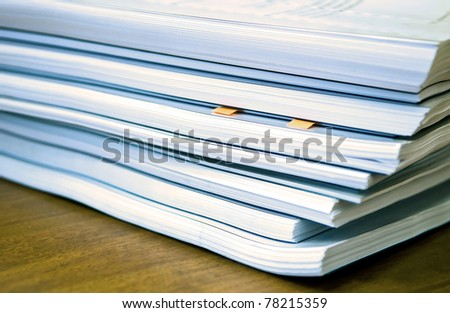Many documents lying on a table - stock photo