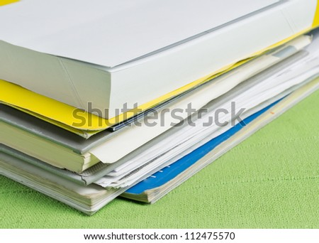 Many documents lying on a table,back to school concept - stock photo