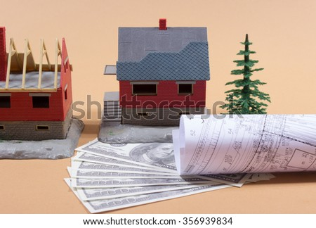 Many dollar banknotes and a house model. - stock photo