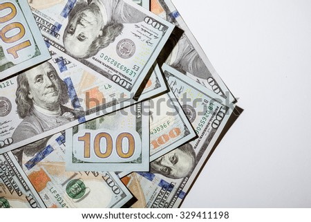 Many dollar banknotes on neutral background - stock photo