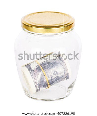 Many dollars bank notes in a glass jar isolated on white background - stock photo