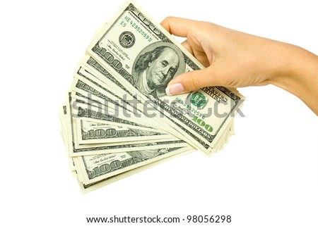 Many dollars falling on woman's hand with money - stock photo