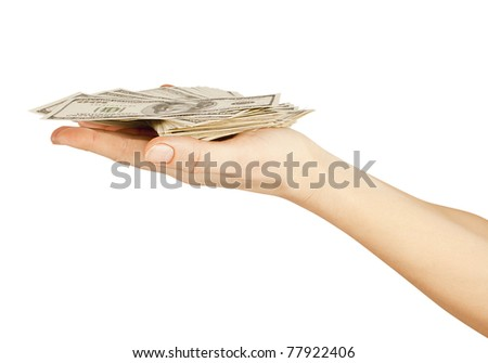 Many dollars falling on womans hand with dollars