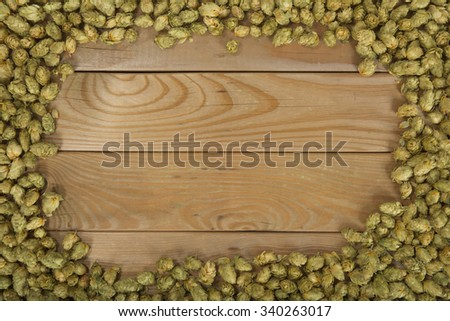 many dried hops on old weathered wooden board