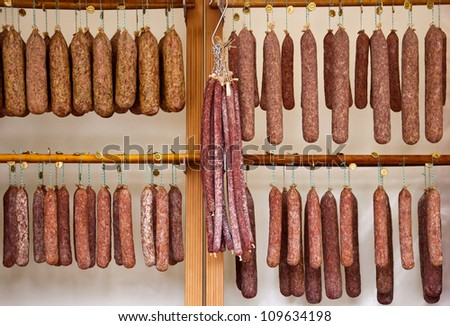 Many dried sausage at the butcher�´s. - stock photo