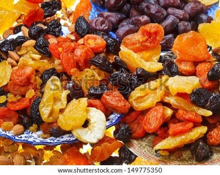 many dried sweet fruits on asian plates