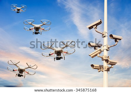 Many drones flying against the blue sky. - stock photo