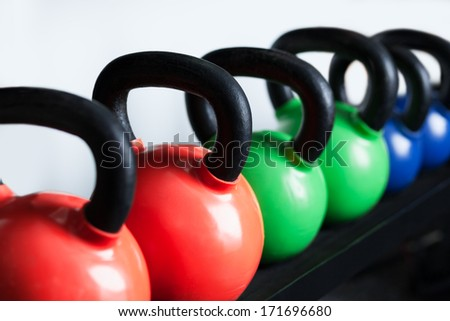 Many dumbbells are on stand at the gym - stock photo